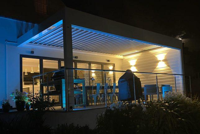 Louvered Pergola Outside Dining Area in Weybridge, Surrey